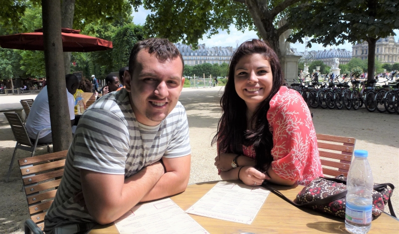Two Davenport students sitting at a table on a study abroad trip.