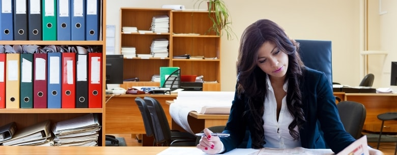A woman working at her desk in an office.